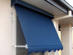 Blue window awning on house in Adelaide
