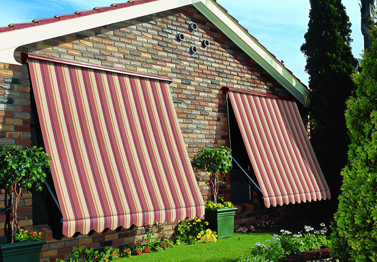 Brick house with stripped window awnings in Adelaide